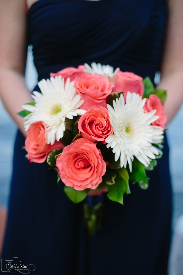 Bridesmaids bouquet of Amsterdam coral roses and white gerber daisies.