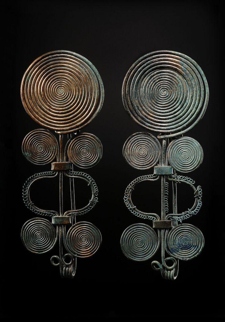 """ A Pair of Bronze Spiral Fibulas Culture : European, Bronze Age Period : late 2nd – early 1st millennium B.C. Material : Bronze """