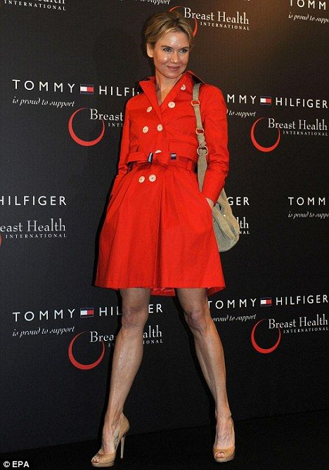 Any regrets? Renee Zellweger showed her ex-boyfriend Bradley Cooper what he was missing today in a sexy trenchcoat while at a Tommy Hilfiger...