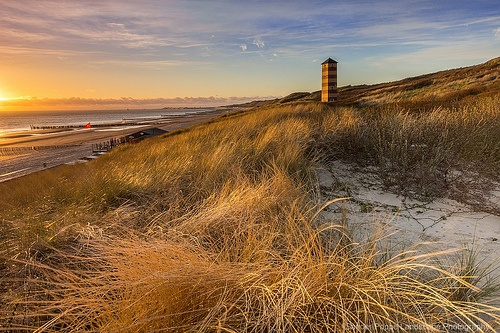 Lighthouse at Dishoek  Last weekend three times been there on out. And only one good photo. Yes, that happens me too. It is part of life as a landscape photographer.  This photo was taken on the dunes of Walcheren. These lighthouses stand near Koudekerke, better known as Dishoek. A few kilometers away from Vlissingen.  More information on: www.sanderpoppe.com  Sony Alpha SLT-A77, Sigma 10-20mm, LEE ND Hard Grad 0.6, LEE ND Soft Grad 0.6, LEE ND Soft Grad 0.9  F11, 1/2sec, ISO100