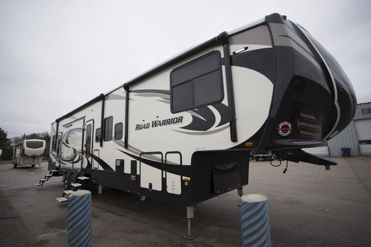 "BIG KID PLAY TIME IS NOW!!!   2018 Heartland Road Warrior RW427  12.5' garage, party deck off the side, and a comfortable living space inside. What more could you want? This 44' 1"" long, 16,698 lb (dry) fifth wheel toy hauler gives you the freedom to ORV and camp anywhere, and when you buy from Lakeshore, you're guaranteed to get the lowest price in the nation.  Give our Road Warrior expert John Sobczak a call 231-903-6220 for pricing and more information."