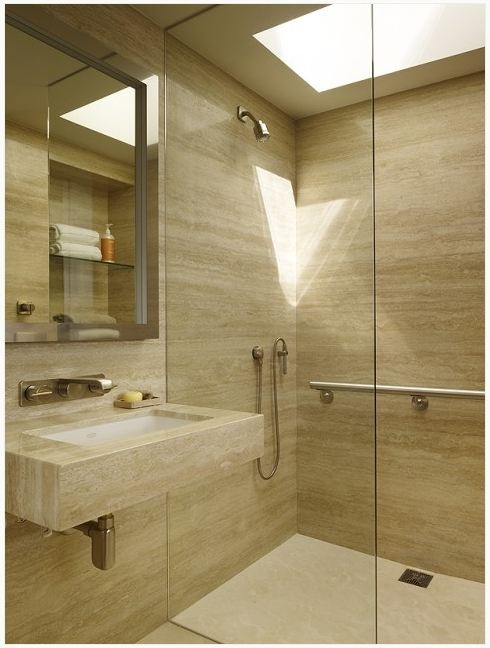 vein cut travertine bathroom tiles - shower V & Company Fine Builders
