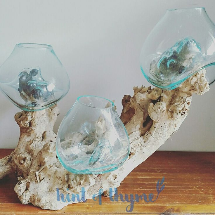 Handmade blown glass bowl on a natural teak wooden base. Triple set with three glass bowls on one piece of wood. Stunning and unique feature piece!