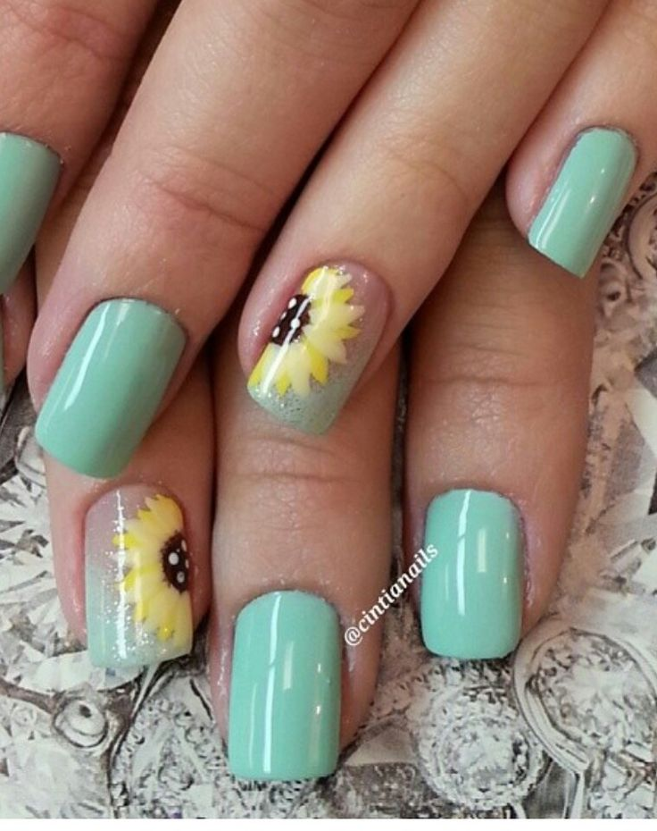 Turquoise blue nails with sunflowers