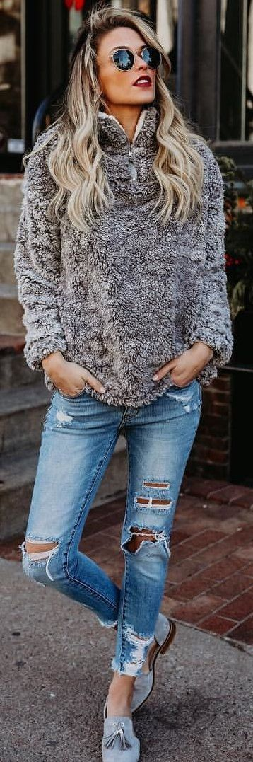 #winter #outfits grey fur pullover jacket with distress blue denim jeans