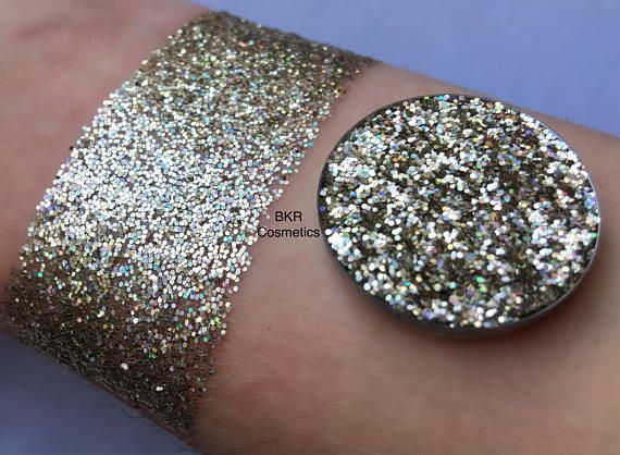 Holographic starstruck pressed glitter eyeshadow, cosmetic grade glitter, glitter eyeshadow, pressed glitter, eyeshadow, glittery, sparkly Shade: Starstruck is a silver gold shade Pictures show glitter swatches with and without a flash. All photos are unedited. Do you love glitter make