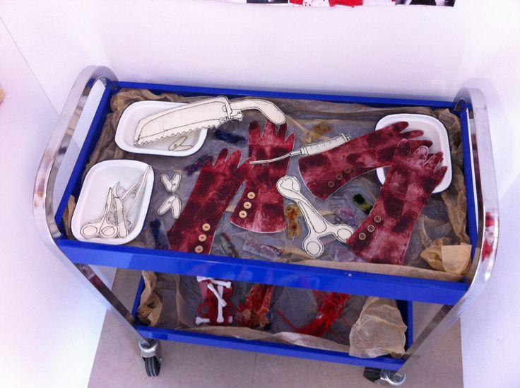 Surgon trolly - tea bag gloves, machine stitched tools, blood slides