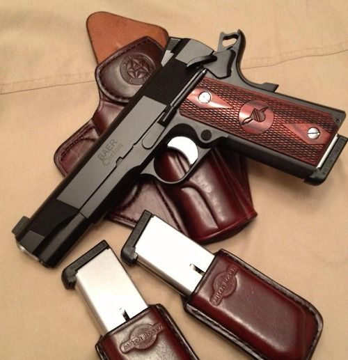 A great looking Les Baer custom 1911 along with some very nice Mitch Rosen leather.