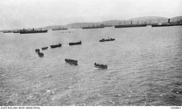Boatloads of Australians leaving the German prize Derfflinger in tow in Mudros Harbour during practice for the landing at Gallipoli Peninsula. The boats carried about thirty five men each.