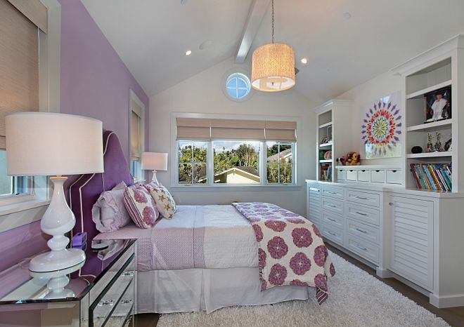 Lavender Teen Bedroom. Lavender inspired room with mirrored nightstands and custom upholstered bed. Large custom built in with fun art. Patterson Custom Homes. Interiors by Trish Steele of Churchill Design.