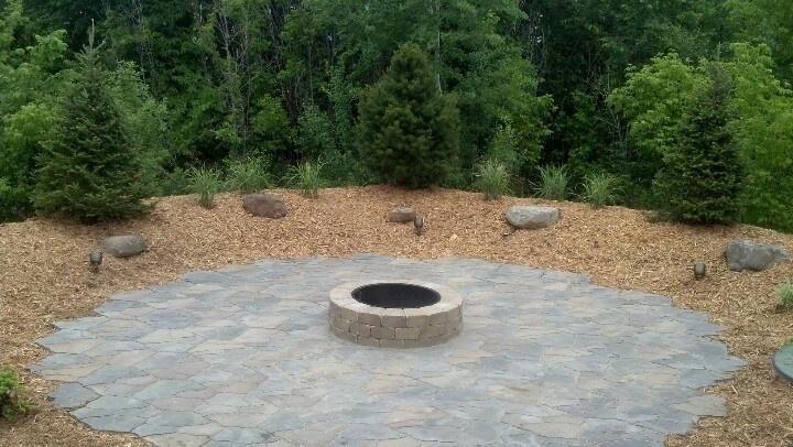 Fire Pit Area Set Inside A Berm With Outcroppings Accent