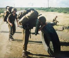 "I'm guessing there are a lot of veterans here looking at this picture and saying .... been there, done that, never again! So much for flipping tyres playing soldier at your ""army boot camp"" Virgin Gym class, this is the real deal! Story for the SA Legion by Peter Dickens"