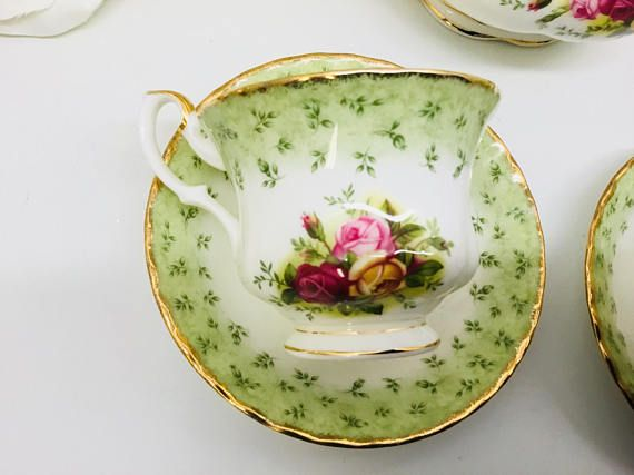 Royal Albert Old Country Roses Tea-set in green. No gold loss, crazing or repairs. There is a indent in the bottom of the teapot lid as seen in photos that I think is there from manufacturing, but in all fairness I felt this should be mentioned. It is the only flaw in this entire