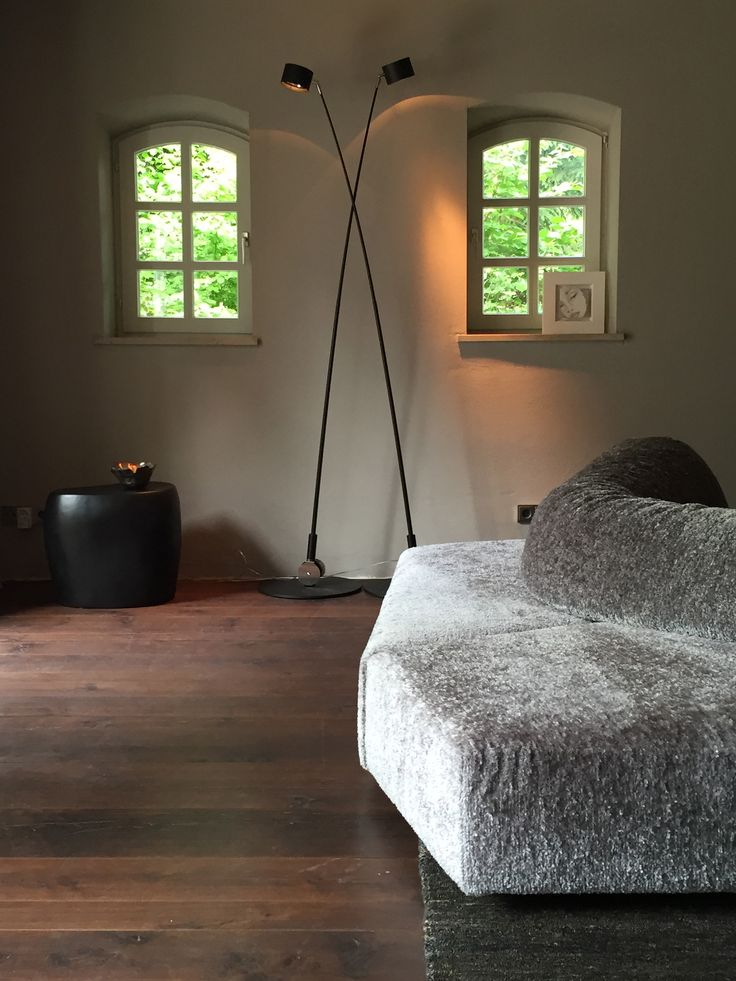 Light 'sampei 230' davide groppi, edra sofa 'on the rocks', imperfettolab side table 'slab', rug 'earth' nani marquina