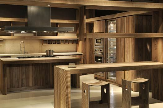 Wood and stone custom made kitchen  displaying sgabello corte | We seek to fill this space with the vibrating echoes, soothed by the intoxication of modern technology, of those never-ending relationships between men and space.