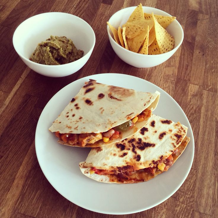 Leftover vegetable and bean chilli with goat's cheese in a quesadilla for a feast-of a-lunch. The chilli has sweet potato, red and green peppers, mushrooms, courgette and sweetcorn in it, plus black eyed beans and borlotti beans. Also homemade guacamole and tortilla chips. Delicious!