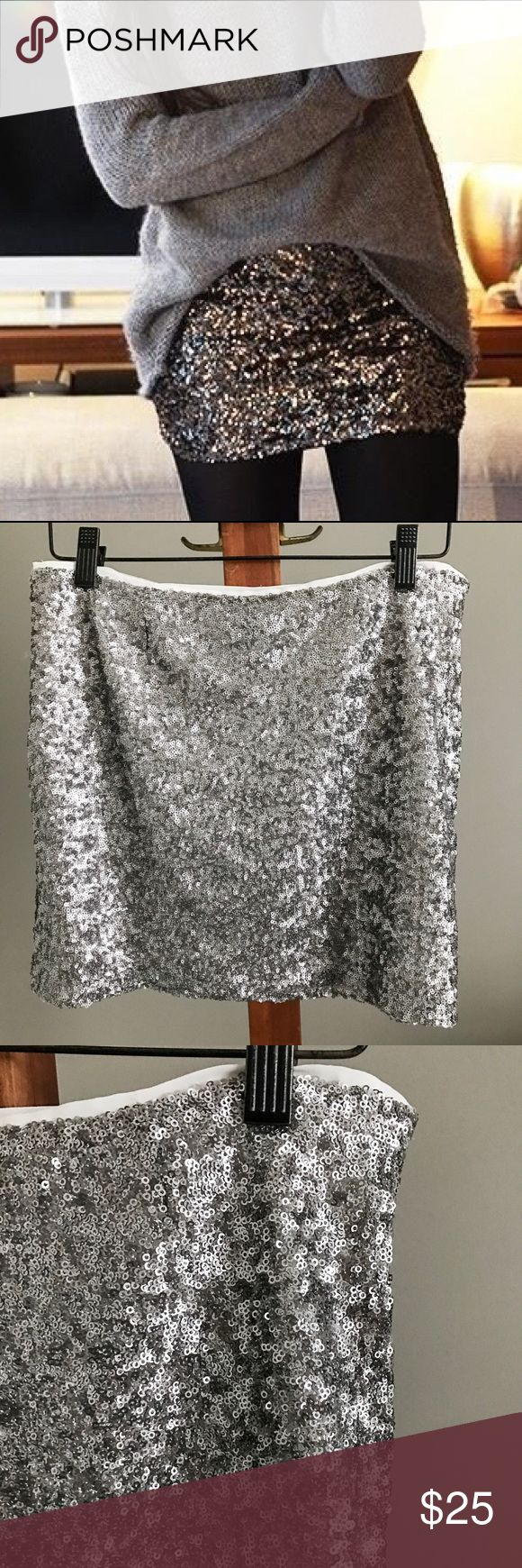GAP Silver Sequin Mini Skirt Gorgeous sequin mini skirt from GAP outlet. Silver sequins. Looks adorable with a sweater as pictured. First photo is for style inspiration only and doesn't show the actual skirt. Size 1, which I think would best translate to a 0. Measurements upon request. Brand new with tags! GAP Skirts Mini