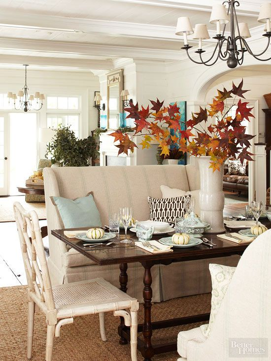 Happily, Mother Nature offers plenty of natural decorative items to situate throughout your seasonally decorated home. Simply fill a vase with leafy cut tree branches to bring the fall factor home./