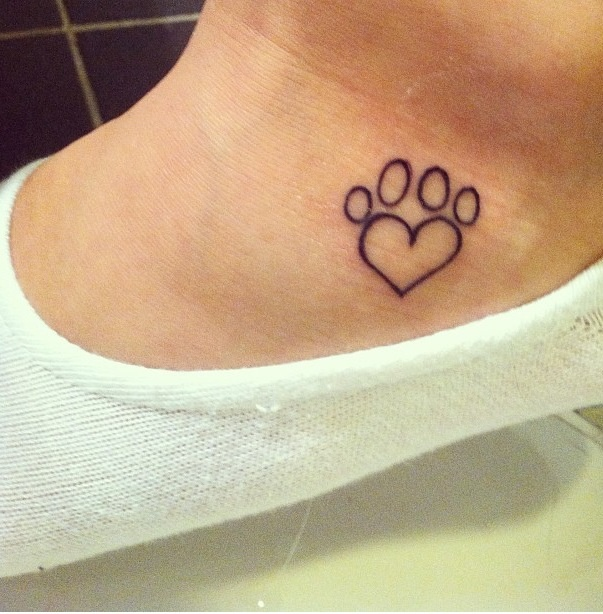 Paw print tattoo on my foot right below ankle bone