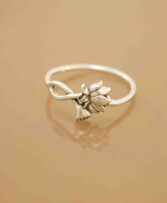 lotus blossom ring .. one in stock. i emailed the seller to see what size. cross your fingers for me!