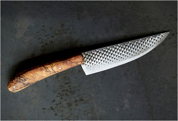 female black smith makes kitchen knives from reclaimed horse-grooming tools