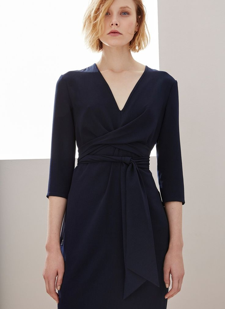 A relaxed fit dress crafted with a V-shaped neckline. It has a nipped-in waist with a tie-around matching belt to enhance the silhouette. Designed with three-fourth length sleeves and two side studded eyelet pockets.