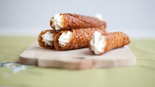 Try piping whipped cream into Mary Berry's classic brandy snaps for a deliciously retro dessert.