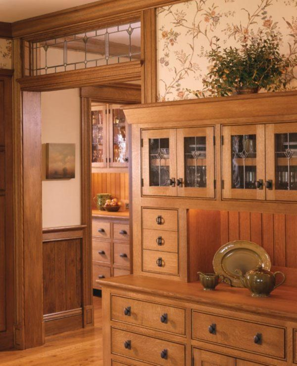 mission cabinets....this sight has lots of kitchen lay outs. I also really like the transom window. putting this on my wish list I already have the windows, this would be a great way to show them off.