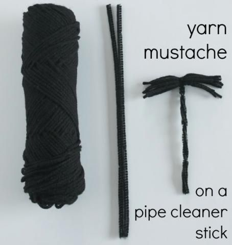 Moustache craft for kids using black yarn & a black pipe cleaner
