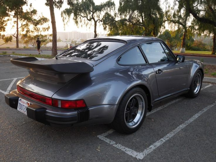 This 1986 Porsche 911 Turbo is said to have been purchased new from George Follmer Porsche and is finished in Meteor Grey Metallic with Black Leather interior. Delivery options included a Blaupunkt Monterey radio, limited-slip differential, electric sport seats, and electric sliding sunroof.
