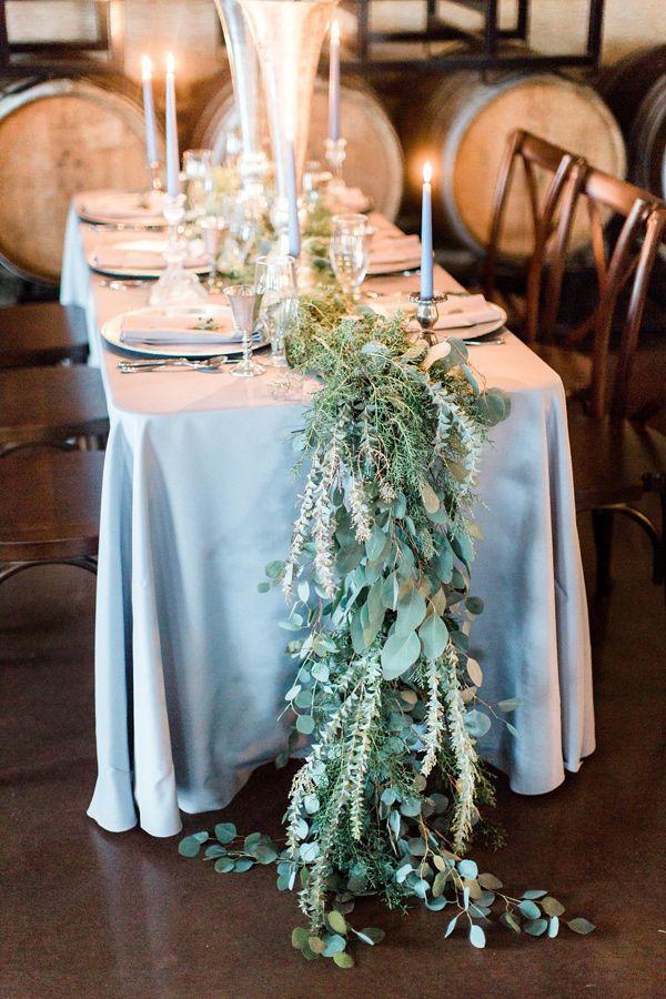 greenery table number - photo by Ashley Errington Photography http://ruffledblog.com/dusty-blue-winter-winery-wedding