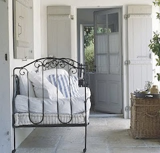 Black Rod Iron Bed...repurposed as porch furniture...
