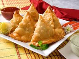 7)Samosas are a popular appetizer is many places such as Pakistan, India, Bangladesh etc. A samosa is a fried or baked dish with a savoury filling such as potatoes, onions, peas, lentils, or minced meat. These fillings are garnished with different spices to add a powerful flavour to them. They are made in a triangular shape so that the filling remains intact. Due to cultural dispersion, they are now made in different regions of the world.