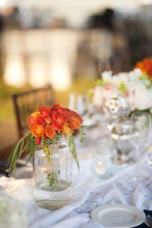 Orange centerpieces (Lauren Larsen)