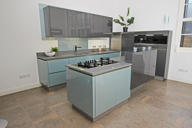 High gloss German Kitchen finish in Steel Blue, perfectly harmonised with the Anthracite gloss Kitchen finish (available to view in our Canary Wharf Kitchen Showroom)