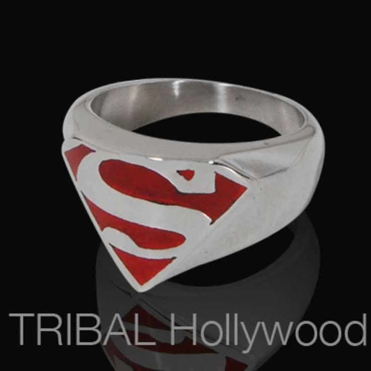 THE SUPERMAN Mens Stainless Steel Ring from Warner Brothers and DC Comics features the iconic Superman 'S' symbol in high grade stainless steel with a bright red textured steel backdrop. Be the all-american hero with the Superman ring for men.