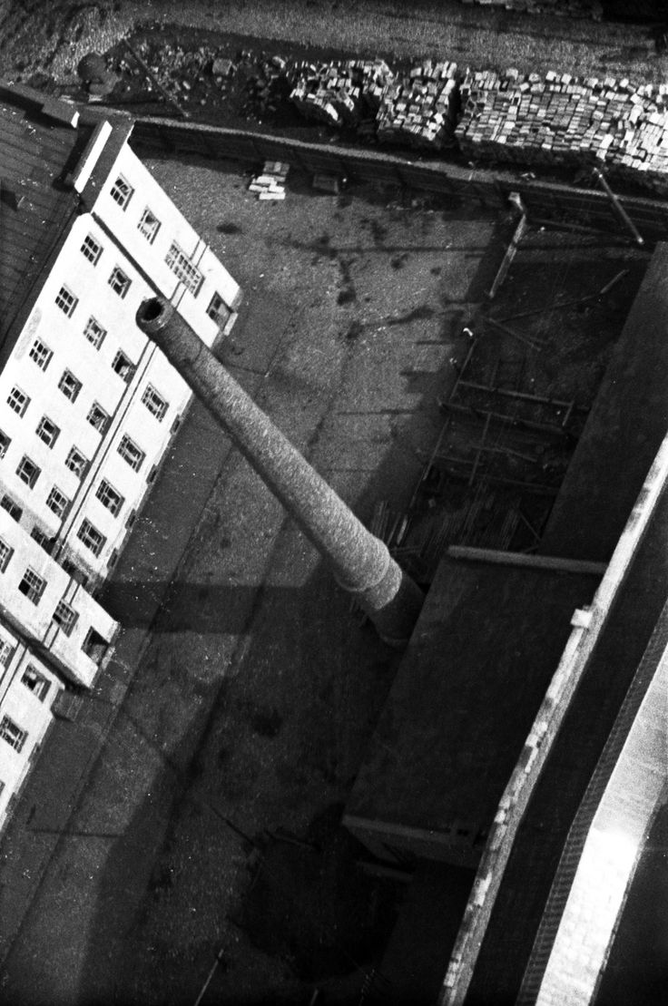 """Factory smokestack, 1931. From a series of photos of Leningrad from the air, taken for the magazine """"USSR in Construction"""". Russia"""