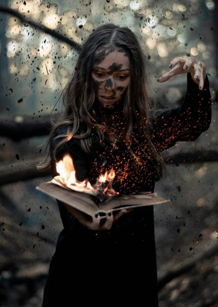 This would have quite the effect for a prop. Build the book with your traditional silk and fan flames, and make a spot light LED with rotating barrel for the embers. To go the extra mile you could do the embers as a peppers ghost reflected on glass.