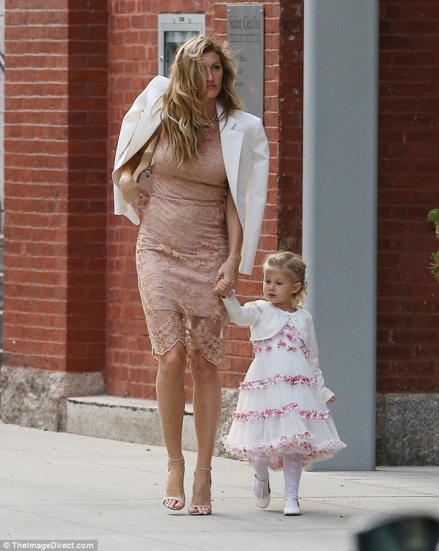 Helping hand: Gisele guided the two-year-old, who wore a cute white-and-pink dress...