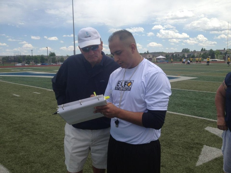 EUROstopwatch Director of Operations (right) Francisco Lujan and UFL head football coach Jim Fassel (Left)