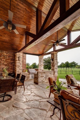 12,946 Porch Design Photos including this patio addition to an existing traditional home. Use of stone for patio, benches and columns. Stained tongue & groove pine ceiling. Heavy timber beams. Lisa Piper Photography