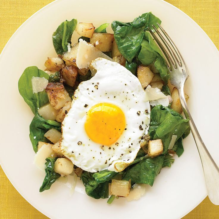 Sunny-side up eggs cook in the wink of an eye, ready to top a spinach salad with potatoes that are sauteed in the same skillet.