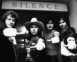 Slade. I loved how they wrote their name on their fingers, I used to copy this all the time.