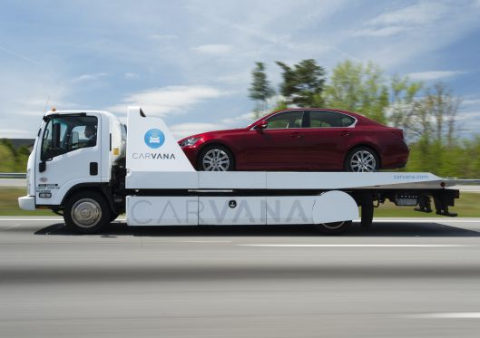 Auto site Carvana tumbles 26% in stock market debut