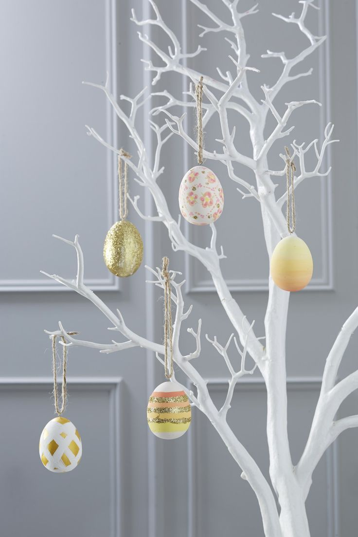 DIY painted Easter eggs, perfect for hanging on your white tree.