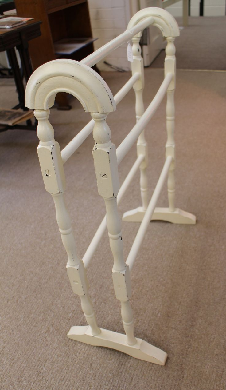 Painted Victorian oak towel rail with 5 bars. Standing 32 inches tall, 24 inches across. Slight warping due to age. Has been painted, distressed and varnished.