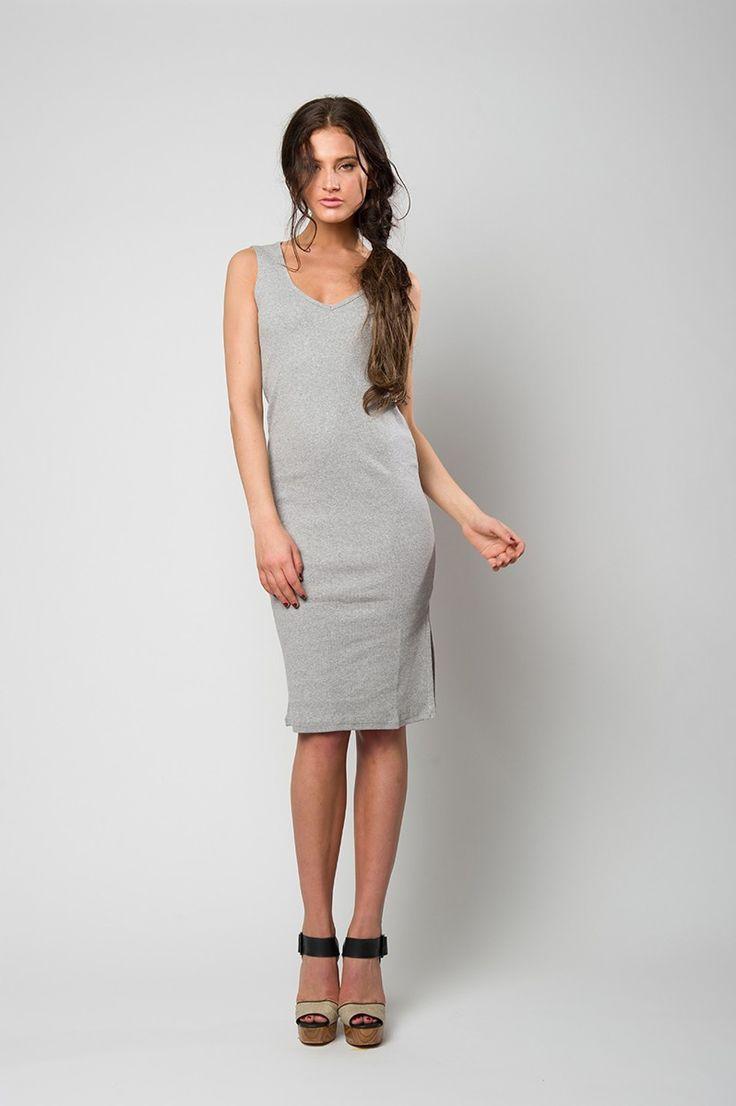 Grey sleeveless ribbed dress with V neck line.