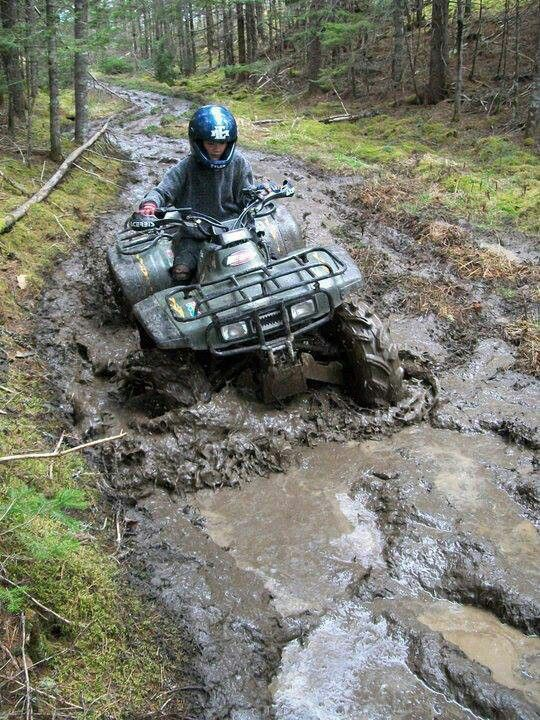 ATV;;mudding so much fun no matter what age you are.