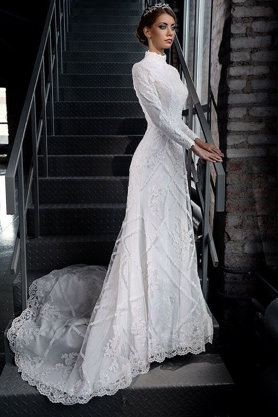 Very elegant dress. Inspired by 19th century wedding gowns. It has a vintage feel . Italian lace is hand beaded. Back is decorated with small