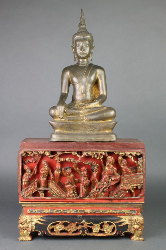 """Lot 308, A Chinese bronze figure of a seated Buddha 14""""h, raised on a 2 section carved gilt wood associated stand, sold for £660"""